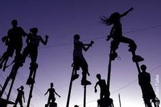 https://www.google.com/search?q=stilt walkers