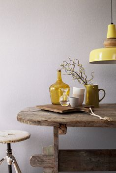 Loving the combination of mustard yellow with rough vintage wooden furniture, yellow glass, grey ceramics, yellow industrial pendant and pale grey walls! Estilo Interior, Interior Styling, Interior Decorating, Interior Design, Shades Of Yellow, Grey Yellow, Mustard Yellow, Yellow Accents, Yellow Interior