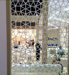 Another glass partition with white geometric pattern.