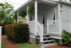Key West style porch with Bahama Shutters
