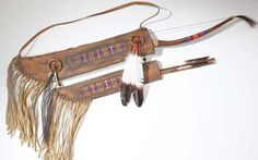 "Native American Beaded Bow & Arrow Quiver; antiqued 45"" by Norman Largo. Each piece comes with a description and a photo of the artist. Foutztrade.com is great collection of navajo handmade and painted dreamcatchers, tomahawks, rattles, arrows and bows, Medicine Wheels, Pipes and others southwestern artifacts #NavajoArtifacts #NavajoIndianArts #NativeAmericanArts #Artifacts #Dreamcatchers #Bows #Arrows #Tomahawks"