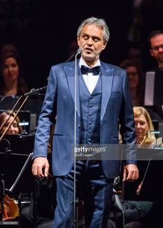 Italian classical crossover tenor, recording artist, and singer-songwriter Andrea Bocelli performs with the Detroit Symphony Orchestra at Little Caesars Arena on December 3, 2017 in Detroit, Michigan.