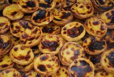 Pasteis de Nata or Pasteis de Belém :  It is believed that pastéis de nata were created before the 18th century by Catholic monks at the Jerónimos Monastery of Belém, in Lisbon.The Casa Pastéis de Belém in Lisbon was the first place outside the convent selling the original creamy dessert, after the monastery was closed in 1820s, and there they are called pastéis de Belém, after the name of the area and its famous bakery. Recipe:http://osaborautentico.blogspot.pt/2012/02/pasteis-de-nata.html