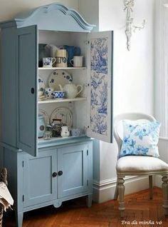 beautiful blue cupboard. Could do toile wallpaper on inside of kitchen cabinets and in a kitchen nook.