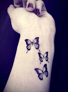 butterfly wrist tattoos.