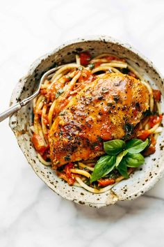 Garlic Basil Chicken with Tomato Butter Sauce - 7 simple ingredients: chicken, pasta, garlic, olive oil, tomatoes, basil, butter. | pinchofyum.com.