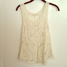 Lace tank top Sheer, cream colored lace tank top. Size: Small. Great condition. Only worn a handful of times Tops Tank Tops