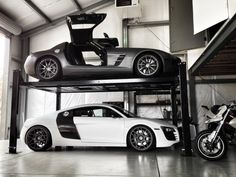 22 Luxurious Garages Perfect for a Supercar - BlazePress If you are ever lucky enough to build your own home and lucky enough to own a supercar then this should certainly be worth a thought - why not build a garage Super Sport Cars, Super Cars, Convertible, Building A Garage, Car Garage, Garage Shop, Garage Lift, Garage Pictures, Automotive Shops