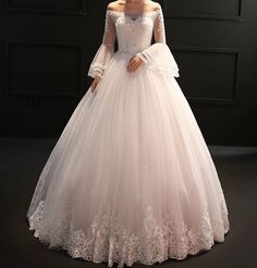 This beautiful off the shoulder wedding gown has beautiful long sleeves. If you are considering #weddingdresses with a unique or bell sleeve this is a lovely option. In addition to custom designs we also make inexpensive #replicaweddingdresses for brides on a tight budget who may have fallen in love with a couture design that is out of their price range. Our version will look similar but cost less. Co tact us at www.dariuscordell.com
