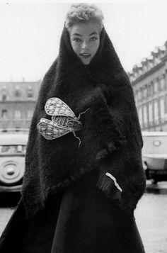 Fiona Campbell-Walter in black boucle shetland stole with insect brooch, both by Schiaparelli. Photo by Robert Randall, November 1952.