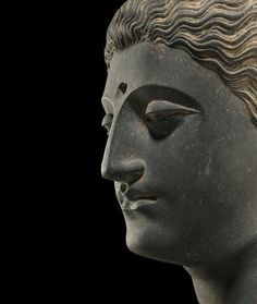 A carved schist head of Buddha, Ancient region of Gandhara, 3rd-4th century