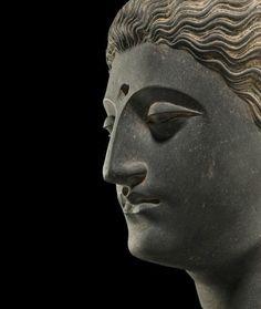 A carved schist head of Buddha, Ancient region of Gandhara, 3rd-4th century