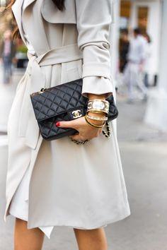 Beige coat + quilted bag.