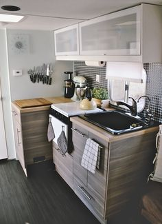 Cover stove top burners with wood cutting boards for more counterspace when not using burners. - Small Space Solutions from Campers & RVs You'll Want For Your Own Home