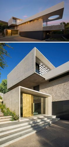 The modern house is made up of rectangular forms that are positioned on top of each other, with some cantilevering out. Upon approaching the house, a wall of stone breaks up the concrete and adds a more natural touch to the home, while the custom-designed brass front door surrounded by glass is like a beacon guiding you to the entrance.