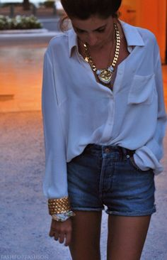 Classic easy white blouse, vintage cutoffs, bold gold jewelry