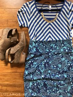 Chevron and paisley lularoe outfit! Gorgeous blue Classic T and Cassie pencil skirt! Brown booties and go! Shop more looks like this here! https://m.facebook.com/groups/1380641358911229