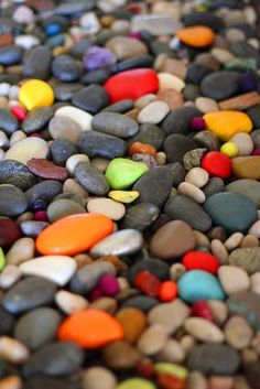 One of my favorite things in our home is our rock garden just inside the entryway. The rocks sit inside a flat, built-in planter and are a mix of plain, smooth river rocks as well as ones I painted.