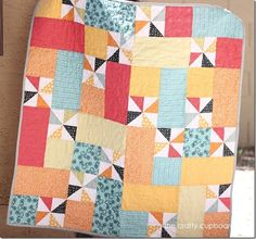 """Pinwheel Baby Boy Quilt. She wants you to buy the pattern, but I'm too cheap. I used 4 1/8"""" squares to make the pinwheels (leaving you with a 6"""" block) and used 6"""" squares and 6""""x11 1/2"""" rectangles. Makes it kind of small, but I threw a boarder on mine and it turned out perfect! So easy!"""