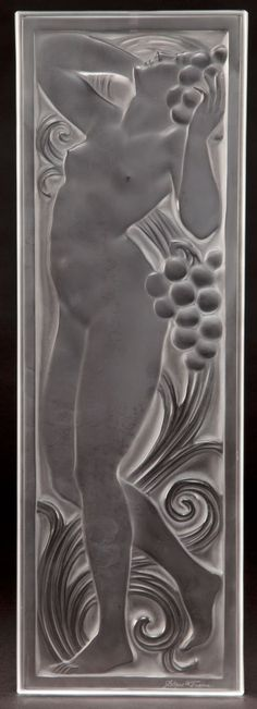 LALIQUE CLEAR AND FROSTED GLASS FIGURINE ET RAISINS  TETE LEVEE ARCHITECTURAL PANEL  Post 1945  Engraved: Lalique, France  17-3/4 inches high x 5-7/8 inches wide (45 x 15 cm)