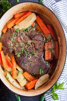 Dutch oven pot roast is juicy and fork tender right from your oven. Add carrots and potatoes that cook inside the rich broth and it's a meal fit for any Sunday night. #potroast #beef #dutchoven #onepanmeals #dinnerideas via @feastandfarm