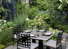 Garden - An outdoor table for four in a garden
