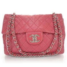 This is an authentic CHANEL Washed Caviar Maxi Flap in Fuchsia.   The classic features and exceptional quality of this Chanel shoulder bag lend a look of timeless elegance for day or evening.