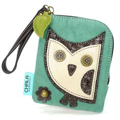 """Chala HooHoo Owl ZipWallet  Fun & Functional Hold your credit cards, ID, currency, and coins all together!  • Cute Owl with stitches and a metal button eyes  • Zippered top closure with leaf charm  • Zippered coin pocket on the back  • Patterned fabric lining  • Antique brass toned hardware  • Currency/ coin compartment  • Multiple credit card slots   Material: Synthetic Suede / leather Color: Teal  Approx. measurements: 4.5""""W x 0.5""""D x 5.5""""H Shop online at www.shopthehandbagstore.com"""