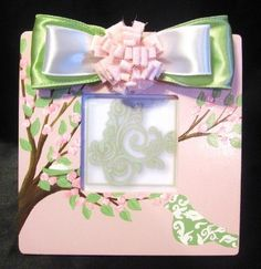 Picture frame for a baby girl - used this for inspiration to paint girl & boy frames for baby gifts....used blue for bot
