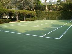 This secret get away Backyard Tennis court is a fun way to get Your Game on!
