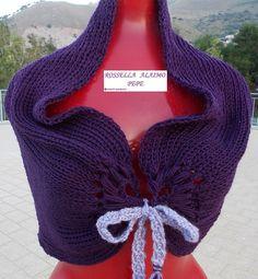 Coprispalle viola Scaldacollo in morbidissima maglia, arricciabile e trasformabile in coprispalle.Articoli in vario colore, ma sempre artigianali e quindi non uguali