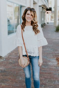 Shein white eyelet peplum blouse, white blouse and jeans outfit, casual spring outfit, summer outfit ideas, spring look, brunette hair with highlights, woven cross body bag, cognac wedges, what to wear on vacation, universal thread target jeans, shoes from target, sole society handbag, cute outfit ideas, woven handbags, beach bag
