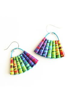 A vibrant pair of fun rainbow dangle earrings made from colorful paper beads. These cool boho chic earrings will instantly brighten up your summer wardrobe. The vibrant rainbow dangles are made from paper beads lovingly handcrafted from rainbow colored paper. Lesbian Gifts, Lesbian Wedding, Paper Beads, Summer Jewelry, Colored Paper, Summer Wardrobe, Rainbow Colors, Boho Chic, Dangle Earrings