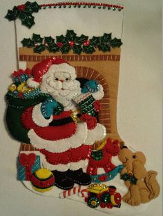 This is a Bucilla Handmade Christmas Stocking. Stocking includes hand stitching, beading and sequins. 18 Long Free Personalization Please indicate when ordering the following - NAME to be used COLOR of thread BLOCK or SCRIPT lettering Will ship completely assembled and ready to hang on the