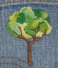 French knot tree on jean.