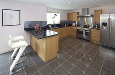 Taylor Wimpey - Typical Interior 2 Example of dark grey titles on floor House, Interior, Home, New Homes For Sale, Dining, New Homes, Kitchen, Flooring, Dining Room