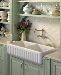 "While the name alone suggests a ""traditional"" style, apron front sinks, are often used in a wide array of settings and can work with any kitchen design. From stone, to stainless steel, to cast iron, these sinks offer a different and interesting look that will make your kitchen stand out. Here's a tip - to find the perfect apron front sink for your kitchen, take into consideration the style of your kitchen, cabinet cut out, the thickness of the sink's material and its moisture and weight."