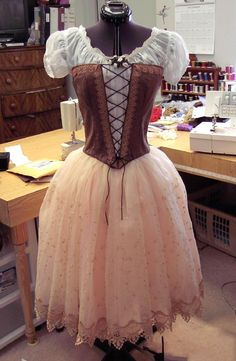 Renaissance peasant type dress. The skirt makes it seem fairy like.