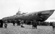 Day trippers crowd around the German Submarine U Boat U118, washed up on the beach at Hastings, East Sussex, in 1919.