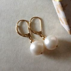 Natural Akoya Pearl 11mm Leverback Earrings 14k For consideration is this handmade 11mm Natural White Akoya Pearl 14k yellow gold Leverback earrings, AA grade. Affordable price reduction. These pearls are full drilled and hallmarked 14k gold. A rare size for akoya pearls, thick nacre. LACustom Designs Jewelry Earrings