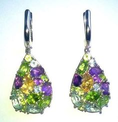Silver earrings with white gold finish. Rocks: citrine, chrysolite, amethyst, topaz. Sold by Jewellry 241,00 $