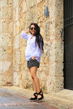 Pure comfort in a white oversized top and flower printed shorts #tourist