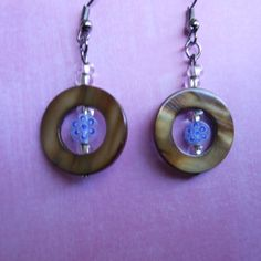 Use the coupon code WEAREOPEN to save 10% on orders overs over $15 as a GRAND OPENING SPECIAL...  Stainless steel hook earrings  with decorative blue mini flower bead in a brown shell ring.