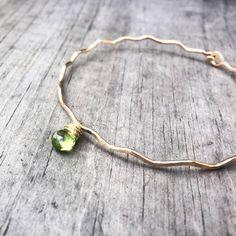A personal favorite from my Etsy shop https://www.etsy.com/listing/208980058/genuine-peridot-bangle-peridot-bracelet