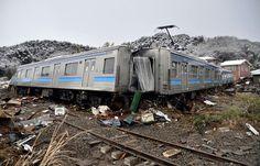 A damaged train off its tracks after an earthquake and tsunami in Matsushima City, Miyagi Prefecture March 12, 2011. #earthquake #tsunami #CabinetHardware.Org #relief