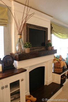 TV recessed into the wall with wires hidden behind the wall, then framed in barn wood to blend into the decor