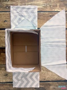 How to turn a cardboard box (like a diaper box) into a fabric covered basket!- How to turn a cardboard box (like a diaper box) into a fabric covered basket! No sew method of making a fabric lined basket to compliment nursery decor! Cardboard Storage, Diy Storage Boxes, Cardboard Box Crafts, Fabric Storage, Craft Storage, Diaper Box Storage, Cardboard Playhouse, Cardboard Furniture, Storage Ideas