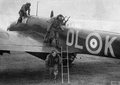 The crew of a No. 83 Squadron Handley Page Hampden exit the aircraft after a successful night's work over Germany, Scampton, 2 October 1940.  The Hampden was one of the RAF's trio of pre-war medium bombers (the Wellington & Whitley were the others): liked by its crews, but the 3 foot wide fuselage made it very cramped.