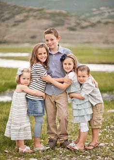 Noah in center, Seth and jake on right & left (one arm, not hugging...) then josh and Ellie on right & left (???)