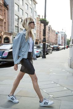 A light blue suede biker jacket and Adidas Superstars go perfectly with a black leather skirt and a white tee.